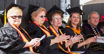 Golden Grads (from left) Etta Weaver, Marita McElvain and Hanna Giesbrecht Hoyt join alumni speaker Marny Fern and President Sheley during commencement on May 29.