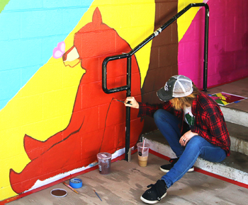 Stan State Art Department students joined with community volunteers to create a mural at Turlock's Columbia Park, supported by former Turlock Mayor Gary Soiseth's Public Policy Award.