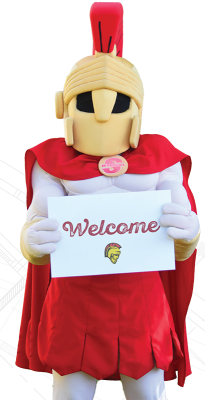 Titus holding Welcome sign