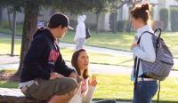 students talking outside
