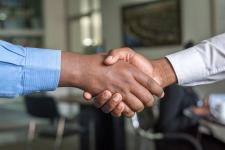 Employer and interviewee shaking hands.