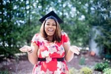 woman in grad cap shruggling shoulders