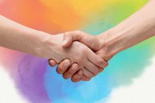 Two individuals shaking hands. Rainbow colored background.