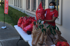 student handing out care packages