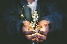 holding bulb in two hands
