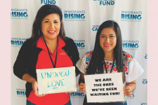 Two women representing undoc-ally with signs to show support saying Undoci-lov and we are the ones we've been waiting for!