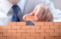 person with building blocks