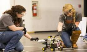 female students testing a small robotic vehicle