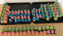 Cupcakes with blue, green, and pink frosting