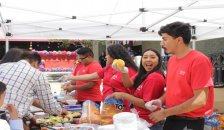 Chicanos Unidos for Academic Achievement club members serving food during event