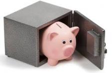 A piggy bank inside a safe