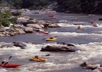 kayaks rafting downriver