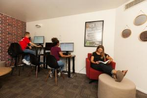 student studying in academic hub
