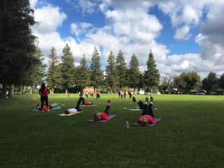 image of people outside doing yoga