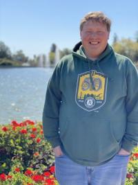 Dr. Bice posing affront of a pond