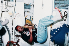 photo of McNair playing saxophone on a space shuttle