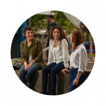 Three female students talking together.