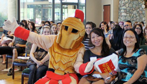 Titus (mascot) with students