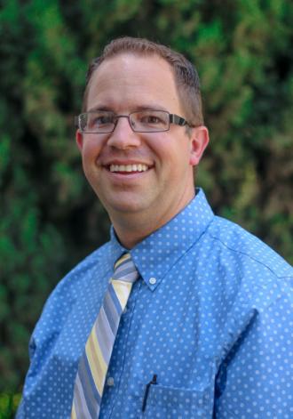 Portrait of Dr. Derek R. Riddle