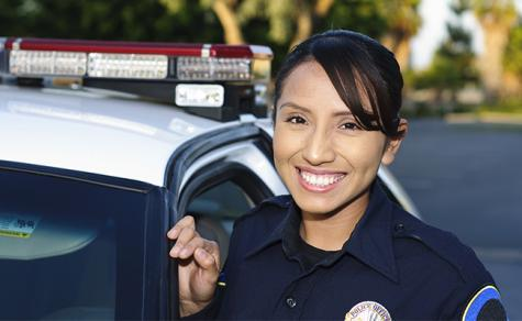Female cop by car