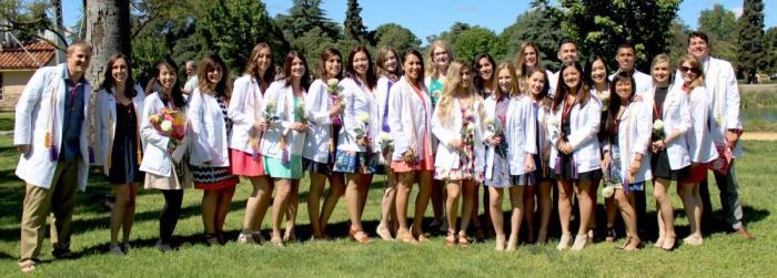 students at white coat ceremony