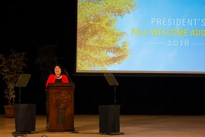President Junn addressing the university