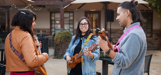 Students playing jarana (an eight-string instrument) at Indigenous Peoples Day