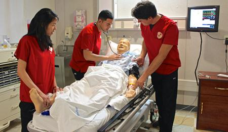 nursing students attending to fake patient