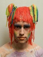 student with orange wig