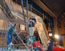Team working on stage  props