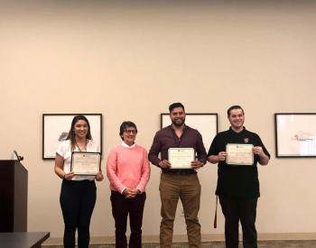 Victoria Morado, Provost Kimberly Greer, Andy Ponce, Kohl James accept an award at the Stan State Student Research Competition