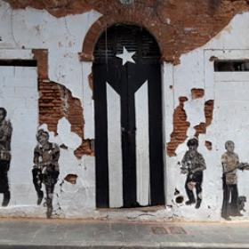 An image of the black and white version of the Puerto Rican flag