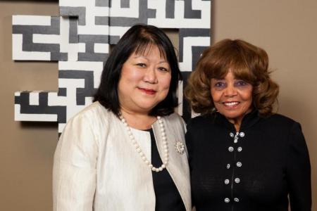 President Ellen Junn and Dr. Marvalene Hughes smile