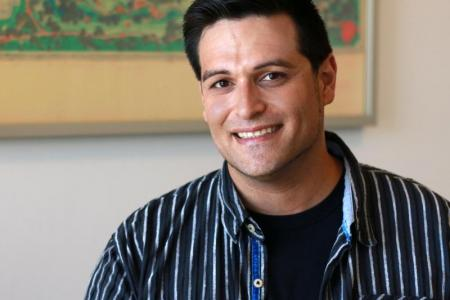 Antonio Garcia smiles after being named scholarship recipient