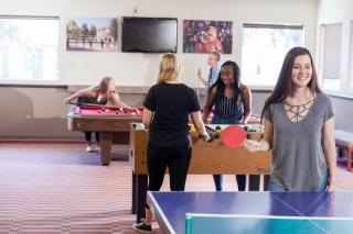 Students in game room