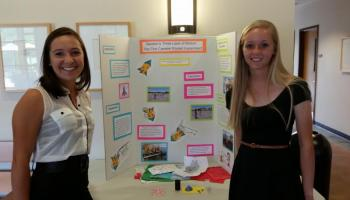 two girls with a presentation board