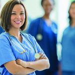 Nurse in scrubs with stethoscope