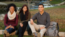 Three students sitting on campus