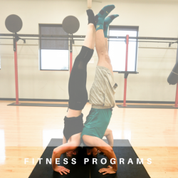 two individuals doing handstand