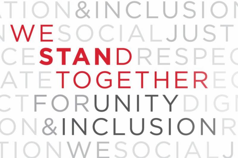 Banner of positive words highlights slogan: We STANd Together for Unity and Inclusion