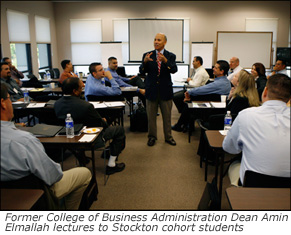 Former College of Business Administration Dean Amin Elmallah lectures to Stockton cohort students