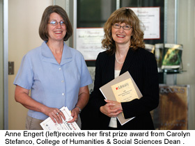 Anne Engert (left) receives her first prize award from Carolyn Stefanco